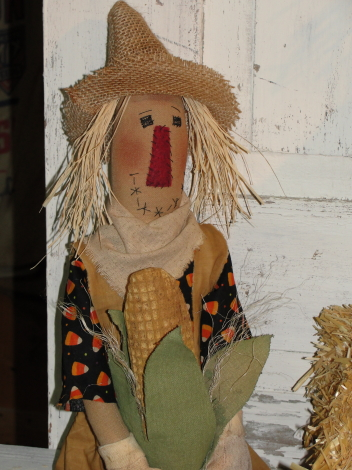 Primitive Fall Sitting Scarecrow with Corn / Candy Corn Shirt