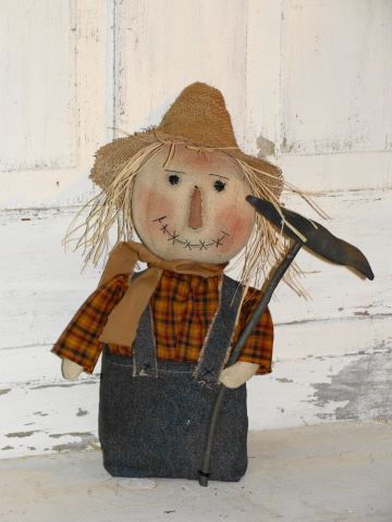 Sitting Scarecrow Holding Crow on a Stick